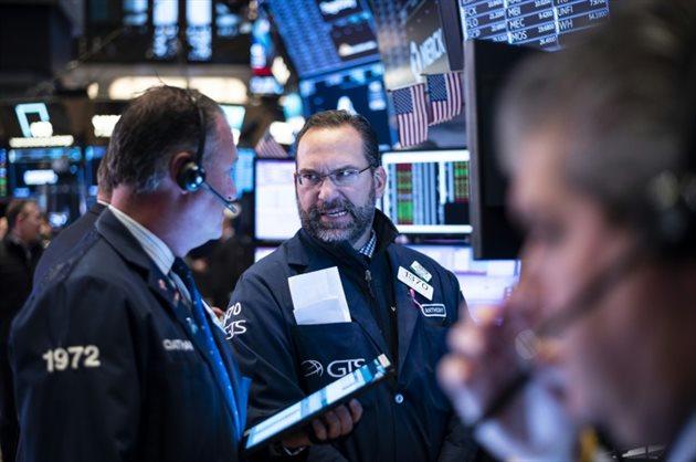 Wall Street limite les dégâts, repli des pétrolières — Marché